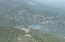 Apagat l'incendi que afecta una zona boscosa de Poblet