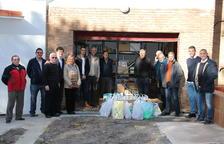 El Nàstic i la Federació de Penyes entreguen els aliments recaptats el diumenge