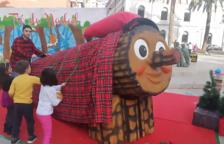 El tió de Nadal ha arribat al Barri del Port de Tarragona