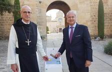 CaixaBank instala en el Monasterio de Poblet un sistema 'de limosna digital' para realizar donativos